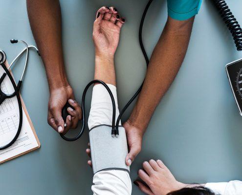 Technician checking blood pressure